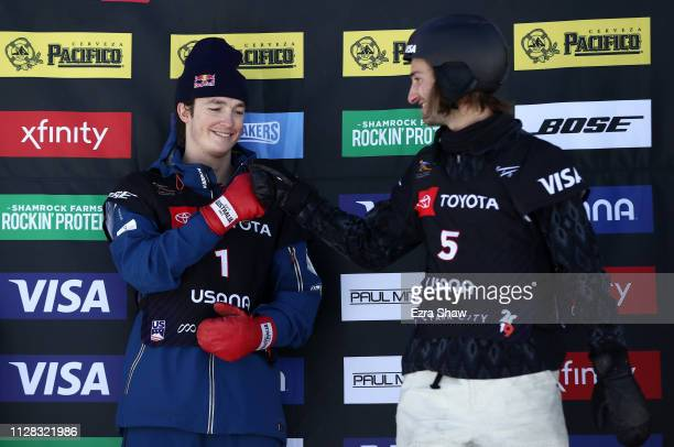 Gold medal winner Scotty James of Australia fist bumps with third place finisher Patrick Burgener of Switzerland on the podium after the Men's...