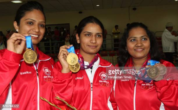 Gold medal winner shooter of Haryana showing their medals after wining the 25 meter Air rifle woman team event in the ongoing 34th National Games at...