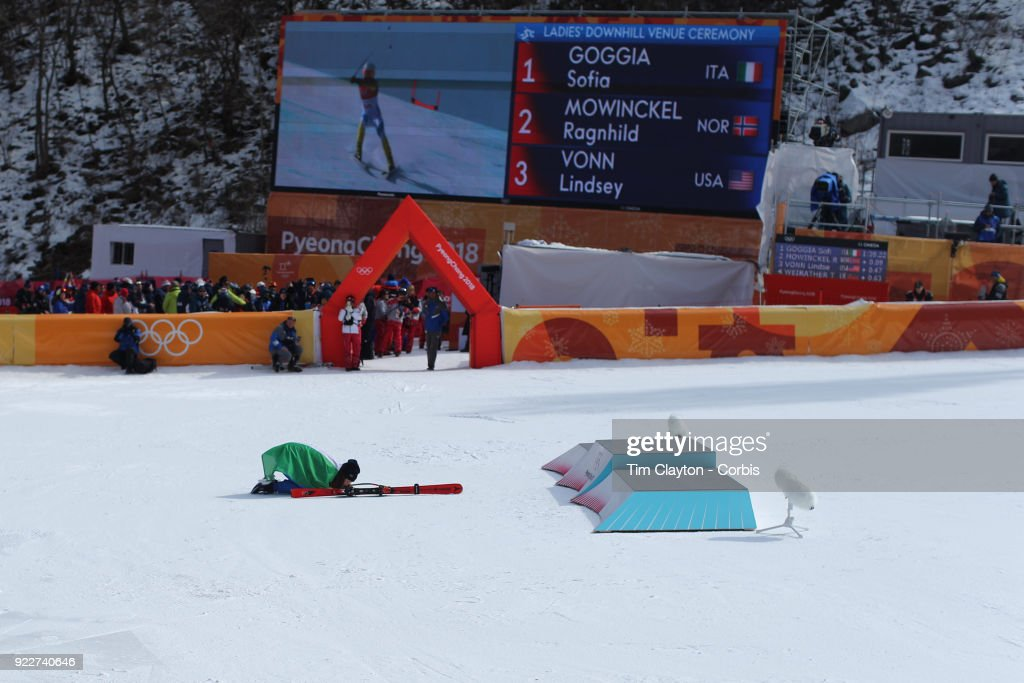 Gold medal winner Sofia Goggia #5 from Italy kisses the snow after the presentation at the finish line during the Alpine Skiing - Ladies' Downhill race at Jeongseon Alpine Centre on February 21, 2018 in PyeongChang, South Korea.
