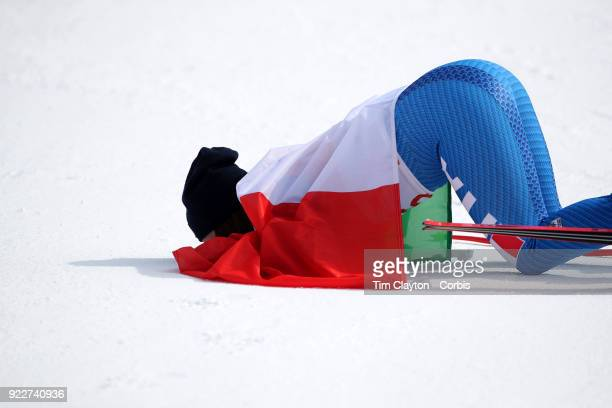 Gold medal winner Sofia Goggia from Italy kisses the snow after the presentation at the finish line during the Alpine Skiing Ladies' Downhill race at...