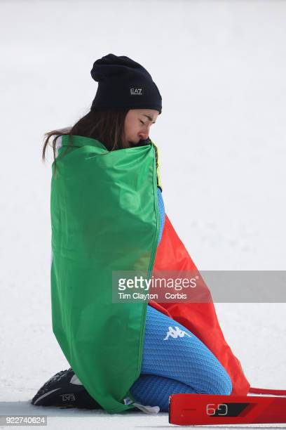 Gold medal winner Sofia Goggia from Italy takes a moment of reflection after the presentation at the finish line during the Alpine Skiing Ladies'...