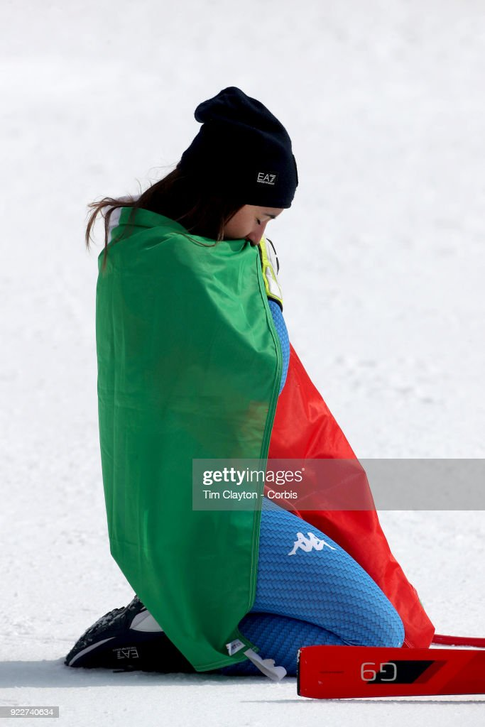 Gold medal winner Sofia Goggia #5 from Italy takes a moment of reflection after the presentation at the finish line during the Alpine Skiing - Ladies' Downhill race at Jeongseon Alpine Centre on February 21, 2018 in PyeongChang, South Korea.
