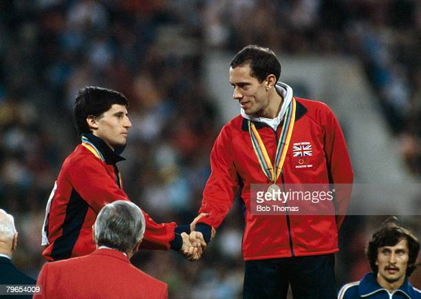 Gold medal winner Steve Ovett of Great Britain shakes hands with his teammate and silver medallist Sebastian Coe during the medal ceremony for the...