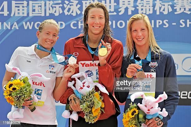 Gold medal winner Switzerland's Swann Oberson , silver medal winner France's Aurelie Muller and bronze medal winner Ashley Grace Twichell of the US...