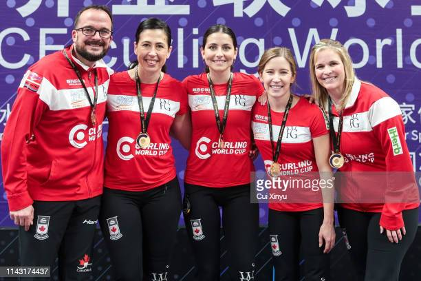 Gold medal winner Team Canada pose for a photo at the award ceremony after the Women's curling final match between Canada and Switzerland on the Day...