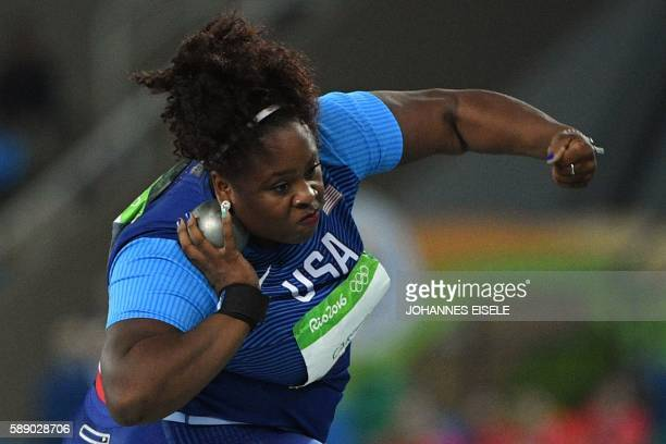 Gold medal winner the USA's Michelle Carter competes in the Women's Shot Put Final during the athletics event at the Rio 2016 Olympic Games at the...
