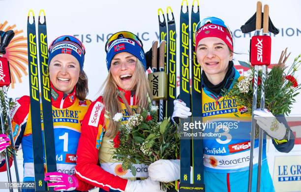 Gold Medal Winner Therese Johaug of Norway Silver Winner Ingvild Flugstad Oestberg of Norway Bronze Winner Natalia Nepryaeva of Russia celebrates...