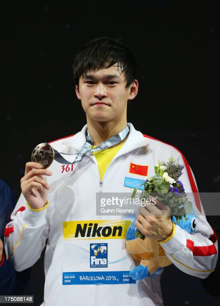 Gold medal winner Yang Sun of China celebrates on the podium after the Swimming Men's 800m Freestyle Final on day twelve of the 15th FINA World...