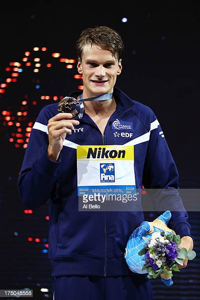 Gold medal winner Yannick Agnel of France celebrates on the podium after winning the Swimming Men's 200m Freestyle Final on day eleven of the 15th...