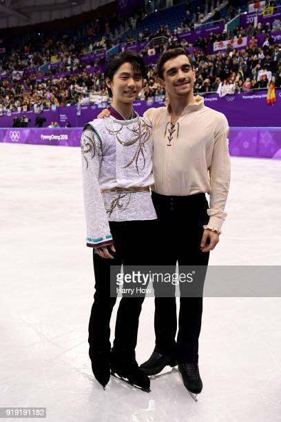 Gold medal winner Yuzuru Hanyu of Japan and bronze medal winner Javier Fernandez of Spain celebrate during the victory ceremony for the Men's Single...