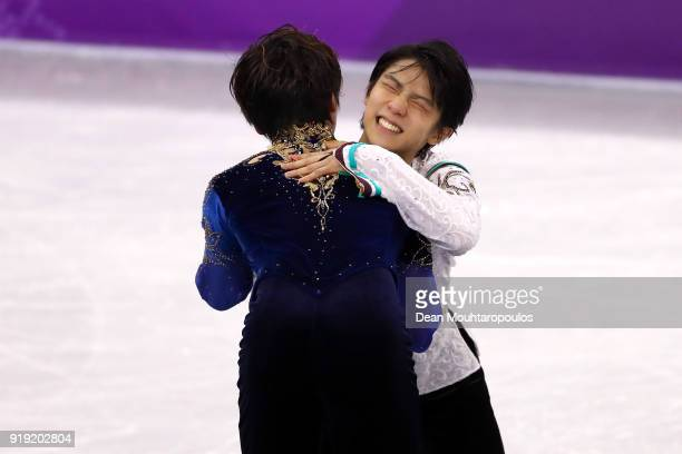 Gold medal winner Yuzuru Hanyu of Japan celebrates with Shoma Uno of Japan during the victory ceremony for the Men's Single Free Program on day eight...