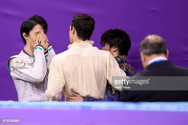 Gold medal winner Yuzuru Hanyu of Japan reacts with bronze medal winner Javier Fernandez of Spain and silver medal winner Shoma Uno of Japan during...