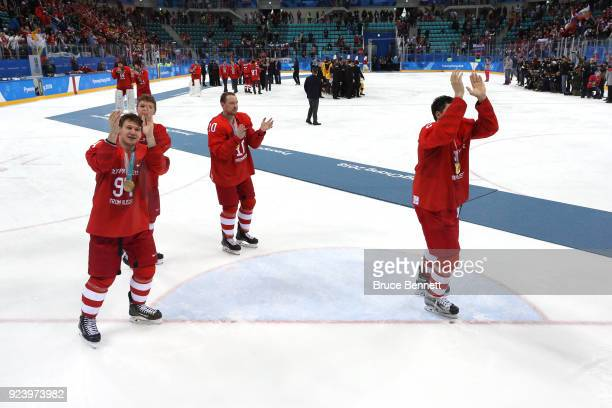 Gold medal winners Alexander Barabanov Sergei Mozyakin and Artyom Zub of Olympic Athlete from Russia of Olympic Athletes from Russia acknowledge the...