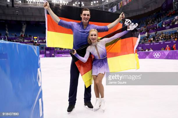 Gold medal winners Aljona Savchenko and Bruno Massot of Germany celebrate during the victory ceremony after the Pair Skating Free Skating at...