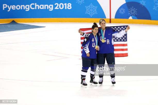 Gold medal winners Amanda Pelkey of the United States and Gigi Marvin of the United States celebrate during the victory ceremony after defeating...