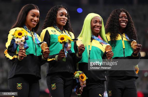 Gold medal winners Briana Williams, Elaine Thompson-Herah, Shelly-Ann Fraser-Pryce and Shericka Jackson of Team Jamaica stand on the podium during...