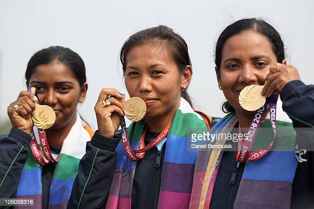 Gold medal winners, Deepika Kumari, Bombayala Devi Laishram and Dola Banerjee of India display their medals after the medal ceremony for the Women's...