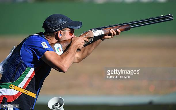 Gold medal winner's Gabriele Rossetti competes during the Skeet men's final at the Olympic Shooting Centre in Rio de Janeiro on August 13 during the...