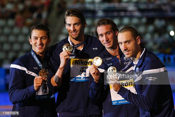 Gold medal winners Giacomo PerezDortona Camille Lacourt Fabien Gilot and Jeremy Stravius of France celebrate on the podium after the Swimming Men's...