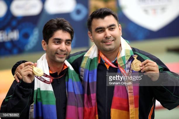Gold medal winners in the Mens 10m Air Rifle Pairs Abhinav Bindra and Gagan Narang of India pose with their medals at Dr Karni Singh Shooting Range...