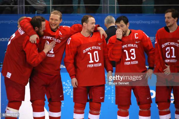 Gold medal winners Ivan Telegin Sergei Andronov Sergei Mozyakin Pavel Datsyuk and Sergei Kalinin of Olympic Athlete from Russia celebrate during the...