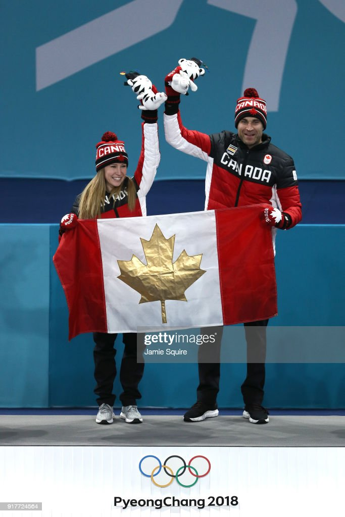 Gold medal winners Kaitlyn Lawes and John Morris of Canada celebrate during the victory ceremony after Curling Mixed Doubles Gold Medal Game on day four of the PyeongChang 2018 Winter Olympic Games at Gangneung Curling Centre on February 13, 2018 in Gangneung, South Korea.