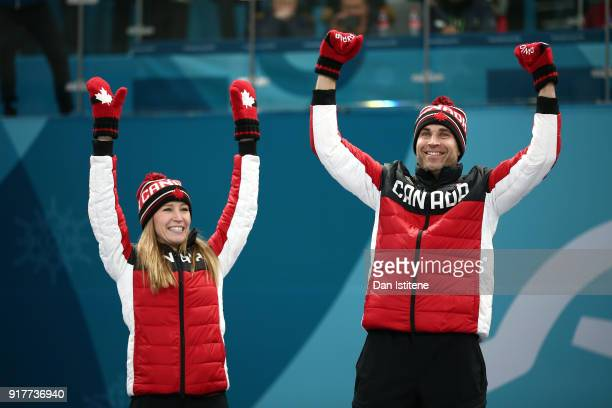 Gold medal winners Kaitlyn Lawes and John Morris of Canada celebrate during the victory ceremony after Curling Mixed Doubles Gold Medal Game on day...