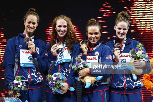 Gold Medal winners Megan Romano Shannon Vreeland Natalie Coughlin and Missy Franklin of the USA celebrate on the podium after the Swimming...