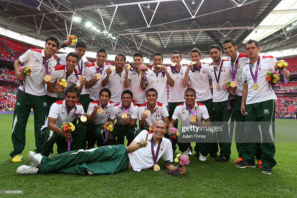 Gold medal winners Mexico pose with their medals after the medal ceremony for the Men's Football Final between Brazil and Mexico on Day 15 of the London 2012 Olympic Games at Wembley Stadium on August 11, 2012 in London, England.