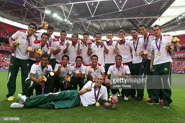 Gold medal winners Mexico pose with their medals after the medal ceremony for the Men's Football Final between Brazil and Mexico on Day 15 of the...