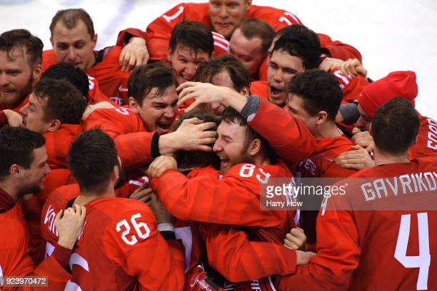 Gold medal winners Olympic Athletes from Russia celebrate after defeating Germany 43 in overtime during the Men's Gold Medal Game on day sixteen of...