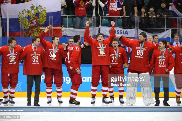 Gold medal winners Olympic Athletes from Russia celebrate during the medal ceremony after defeating Germany 4-3 in overtime during the Men's Gold...