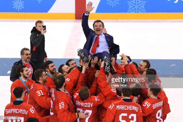 Gold medal winners Olympic Athletes from Russia lift head coach Oleg Znarok over center ice after defeating Germany 43 in overtime during the Men's...