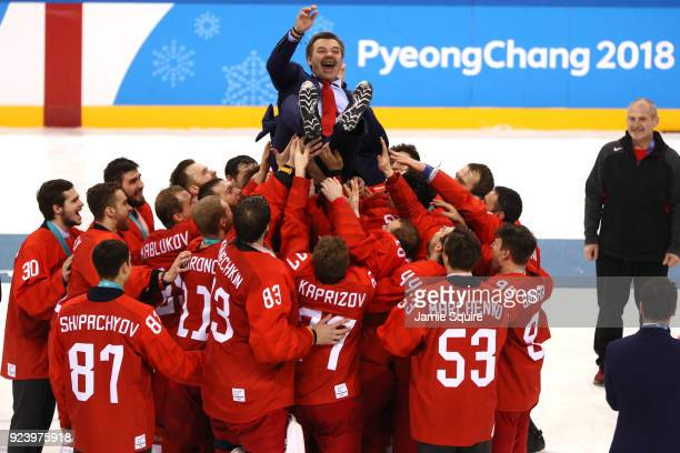 Gold medal winners Olympic Athletes from Russia lift head coach Oleg Znarok over center ice after defeating Germany 4-3 in overtime during the Men's...
