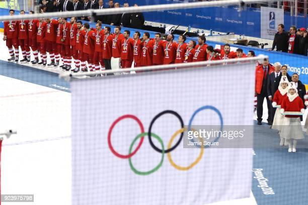 Gold medal winners Olympic Athletes from Russia look on as the Olympic flag is raised during the medal ceremony after the Men's Gold Medal Game...