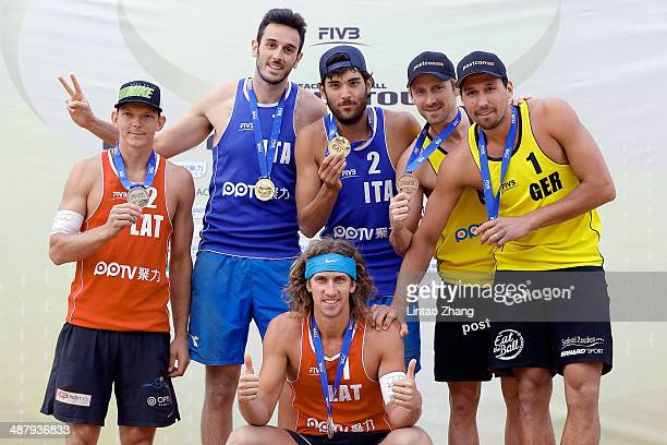 Gold medal winners Paolo Nicolai and Daniele Lupo of Italy with silver medal Aleksandrs Samoilvs and Janis Smedins of Latvia and Jonathan Erdmann and...