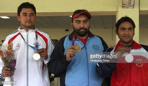 Gold medal winners Rojon Sodi of Punjab Silver medal Ansab Uttar Pradesh and Bronze medal winner Himanshu of Services of Haryana showing their medal...