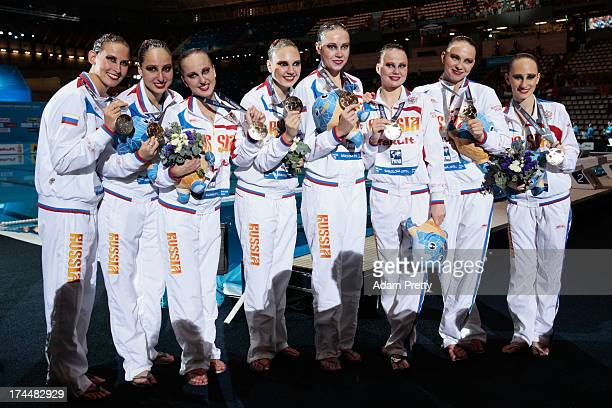 Gold medal winners Russia celebrate after the Synchronized Swimming Team Free Final on day seven of the 15th FINA World Championships at Palau Sant...