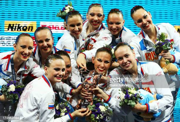 Gold medal winners Russia celebrate and pose with their award for Best National Federation after winning the Synchronized Swimming Free Combination...