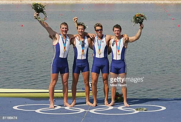 Gold medal winners Steve Williams, James Cracknell, Ed Coode and Matthew Pinsent of Great Britain stand on the podium during the medal ceremony for...