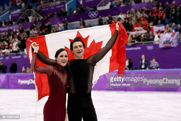 Gold medal winners Tessa Virtue and Scott Moir of Canada celebrate during the victory ceremony for the Figure Skating Ice Dance Free Dance on day...