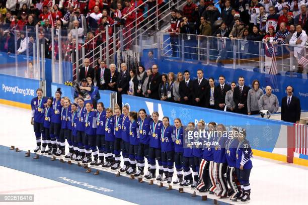 Gold medal winners the United States celebrate during the victory ceremony after defeating Canada in a shootout in the Women's Gold Medal Game on day...