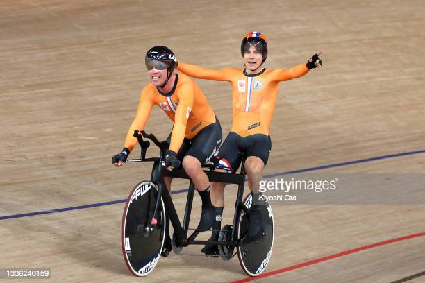 Gold medal winners Tristan Bangma and pilot Patrick Bos of Team Netherlands react after competing in the track cycling Men's B 4000m Individual...