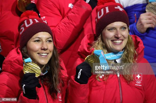 Gold medal winners Wendy Holdener and Denise Feierabend of team Switzerland celebrate during the medal ceremony for the Alpine Team Event on day...