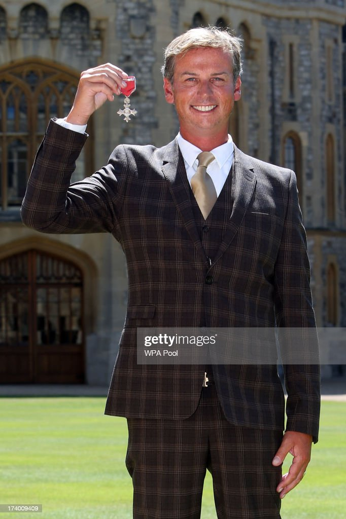 Gold medal winning Olympic Dressage rider Carl Hester after he is made a Member of the Order of the British Empire (MBE) by Queen Elizabeth II during an Investiture ceremony at Windsor Castle on July 19, 2013 in Windsor, England.