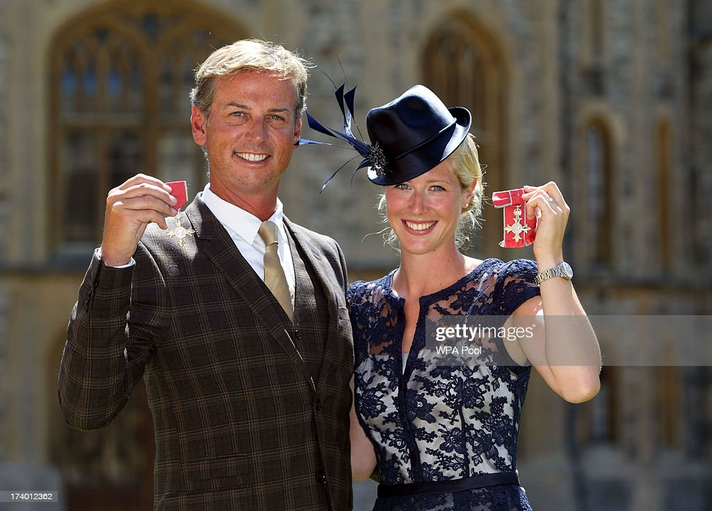 Gold medal winning Olympic Dressage riders Carl Hester and Laura Tomlinson after they are made Members of the Order of the British Empire (MBE) by Queen Elizabeth II during an Investiture ceremony at Windsor Castle on July 19, 2013 in Windsor, England.