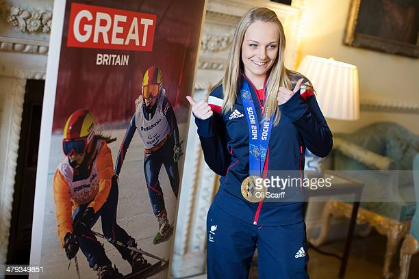 Gold medal winning skier Charlotte Evans a member of the Winter Paralympic Team GB poses for a photo in Downing Street upon the team's return from...