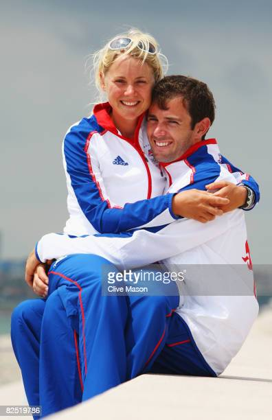 Gold medal winning Yngling skipper Sarah Ayton of Great Britain poses with her fiancee RSX windsurfer Nick Dempsey at the Qingdao Olympic Sailing...