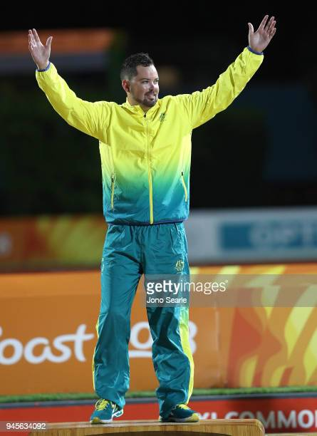 Gold medalist Aaron Wilson of Australia celebrates during the medal ceremony after the men's singles gold medal match between Aaron Wilson of...