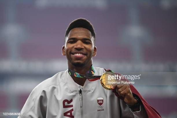 Gold medalist Abderrahman Samba of Qatar celebrates on the podium during the victory ceremony of Men's 400m Hurdles on day nine of the Asian Games on...